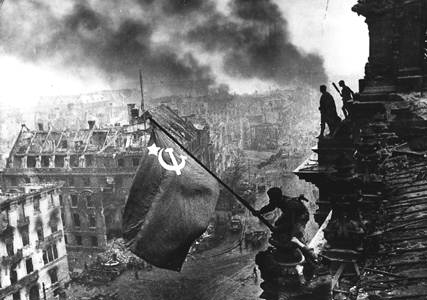 Famous photo of Red Army soldier hoisting the Soviet flag over Berlin. (The US equivalent has American GI's raising the flag on Iwo Jima).